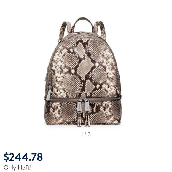 369da7427a30 Michael Kors Rhea Snake Print Backpack. M_5a52f78a72ea88517a01a84a